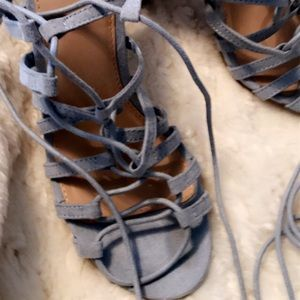Heels with long straps wrap around the ankles